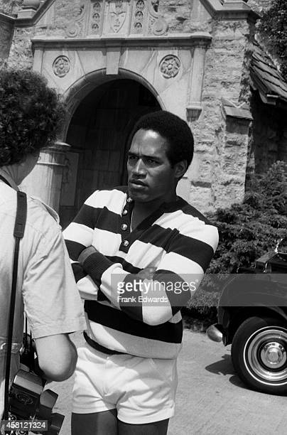 Hugh Hefner hosts his guest NFL player and actor OJ Simpson at the Playboy Mansion in May 1979 in Los Angeles California