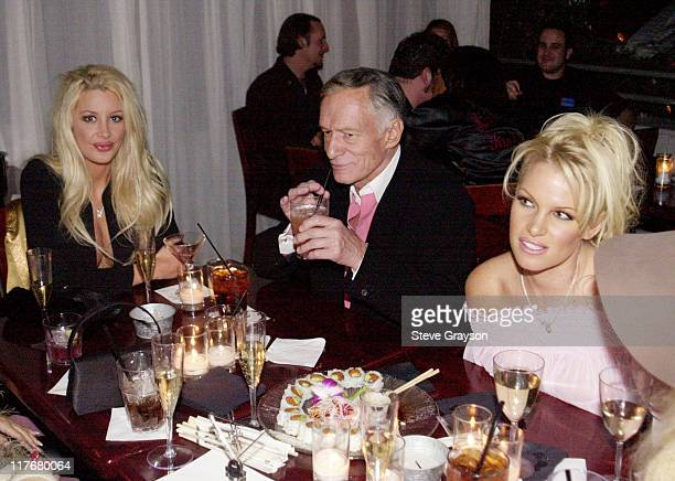 Hugh Hefner Playmates during Start A Heart Honors Lakers Broadcaster Chick Hearn at The Sky Bar in West Hollywood California