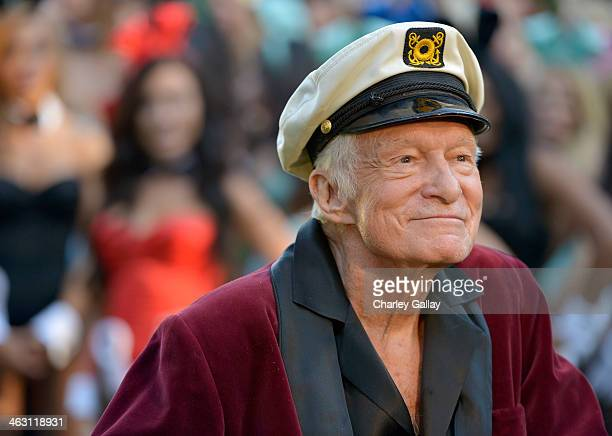 Hugh Hefner poses at Playboy's 60th Anniversary special event on January 16 2014 in Los Angeles California