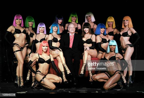 Hugh Hefner poses for photos with the cast of Crazy Horse Paris at the MGM Resort Casino on October 21 2010 in Las Vegas Nevada