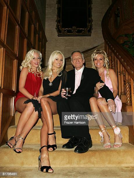 Hugh Hefner poses with Playboy Models at the Yves Saint Laurent Grand classics Screening of 'Sweet Smell of Sucess' hosted by Ben Stiller and...