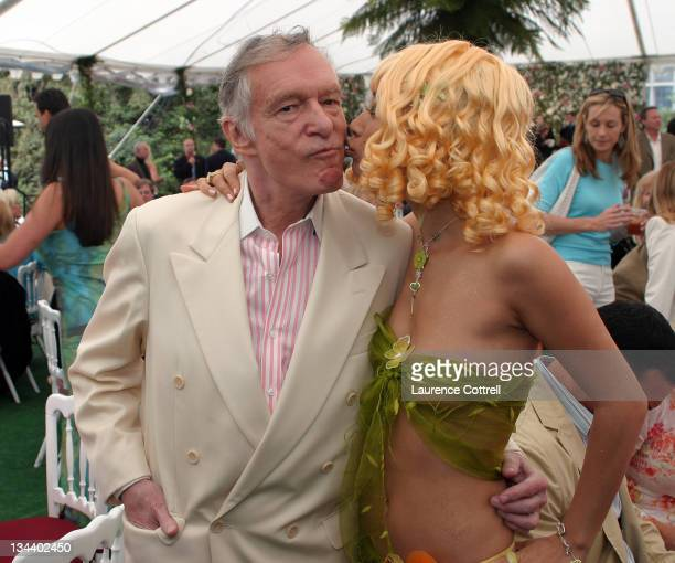 Hugh Hefner with Bai Ling during Playboy Magazine Introduces 2005 Playmate of the Year Tiffany Fallon at Playboy Mansion in Los Angeles California...
