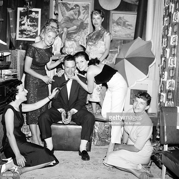 Hugh Hefner with Joan Bradshaw and girls at a Play Boy Party in Los Angeles California
