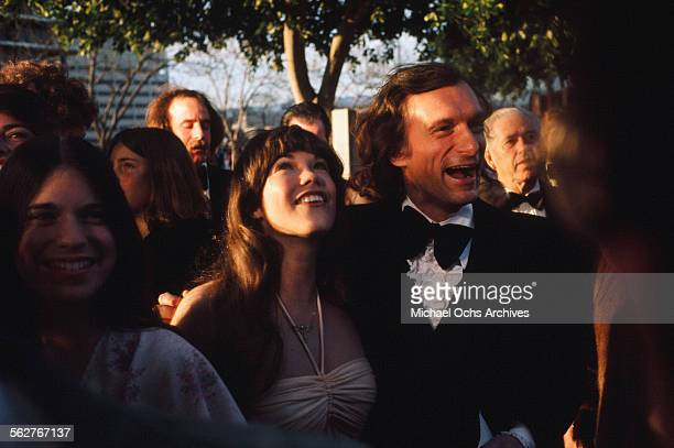 Hugh Hefner with Playmate Barbi Benton arrives to the 46th Academy Awards at Dorothy Chandler Pavilion in Los AngelesCalifornia