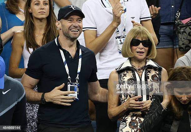 Hugh Jackman and Anna Wintour attend the match between Roger Federer of Switzerland and Gael Monfils of France during Day 11 of the 2014 US Open at...