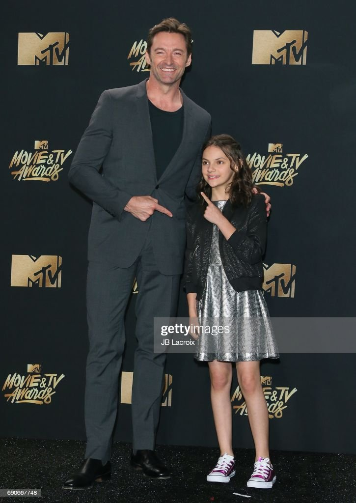 Hugh Jackman and Dafne Keen pose in the press room at the 2017 MTV Movie and TV Awards at The Shrine Auditorium on May 7, 2017 in Los Angeles, California.