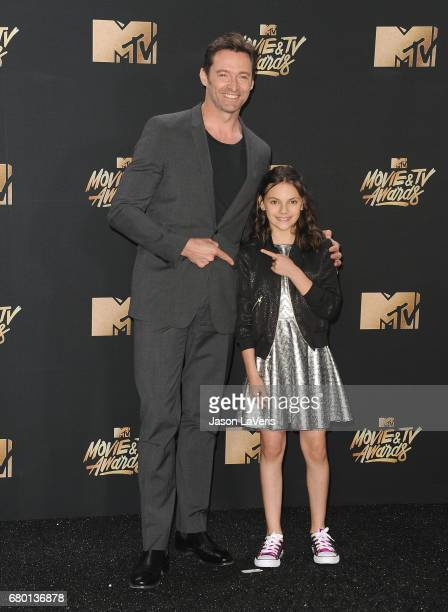 Hugh Jackman and Dafne Keen poses in the press room at the 2017 MTV Movie and TV Awards at The Shrine Auditorium on May 7 2017 in Los Angeles...