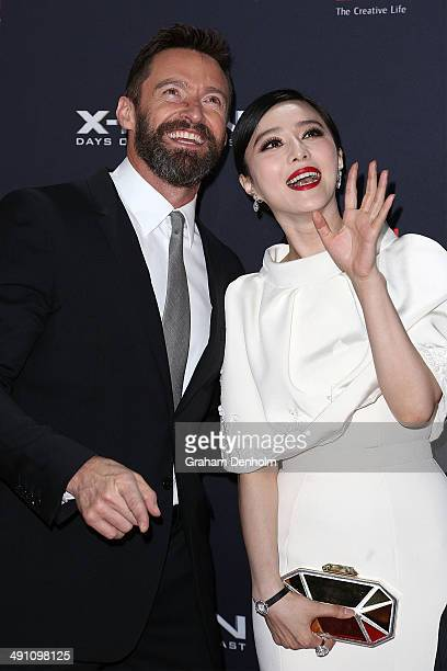 Hugh Jackman and Fan Bingbing wave to fans as they arrive at the Australian premiere of 'XMen Days of Future Past' on May 16 2014 in Melbourne...