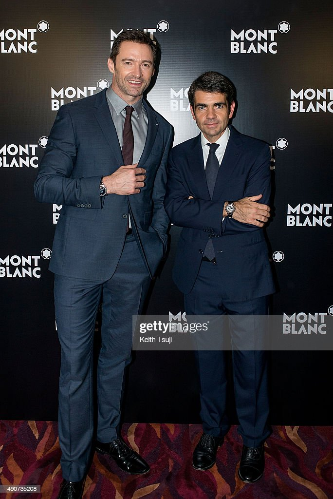 Hugh Jackman and Montblanc CEO Jerome Lambert attend a photo call at the Montblanc Gala Dinner during Watches and Wonders 2015 Exhibition in Grand...
