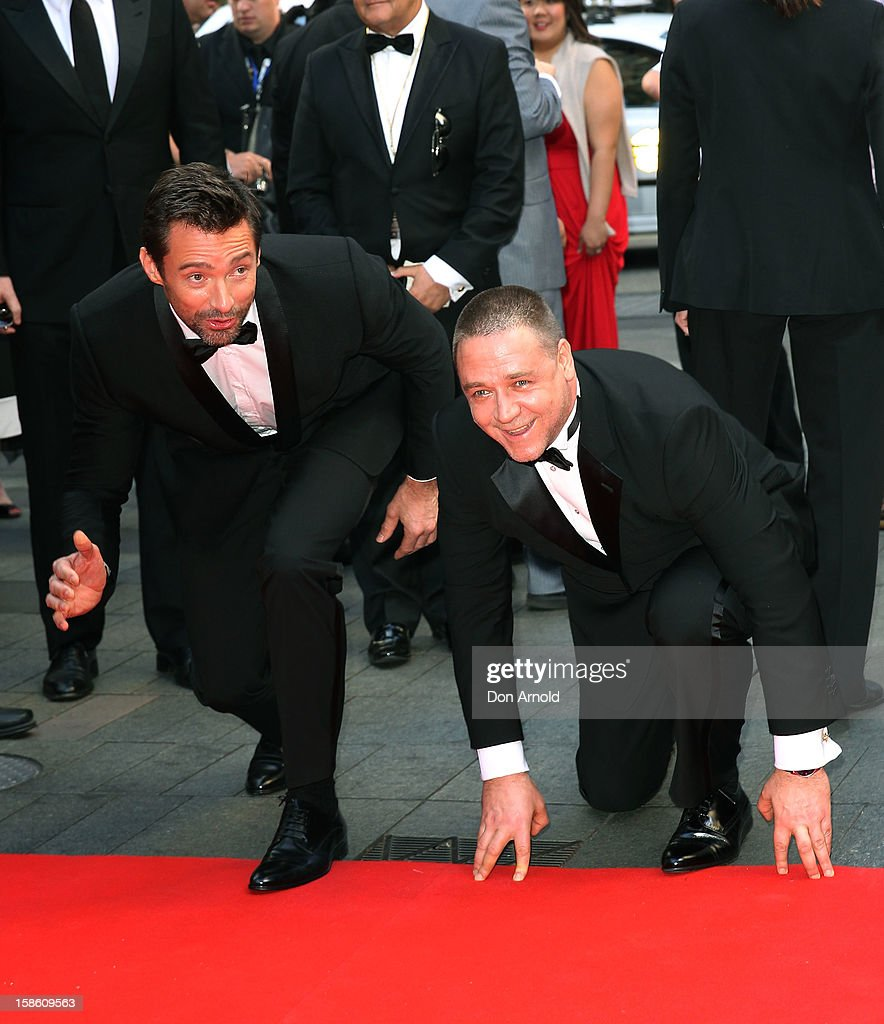 <a gi-track='captionPersonalityLinkClicked' href=/galleries/search?phrase=Hugh+Jackman&family=editorial&specificpeople=202499 ng-click='$event.stopPropagation()'>Hugh Jackman</a> and <a gi-track='captionPersonalityLinkClicked' href=/galleries/search?phrase=Russell+Crowe&family=editorial&specificpeople=202609 ng-click='$event.stopPropagation()'>Russell Crowe</a> play up for the cameras during the Australian premiere of 'Les Miserables' at the State Theatre on December 21, 2012 in Sydney, Australia.