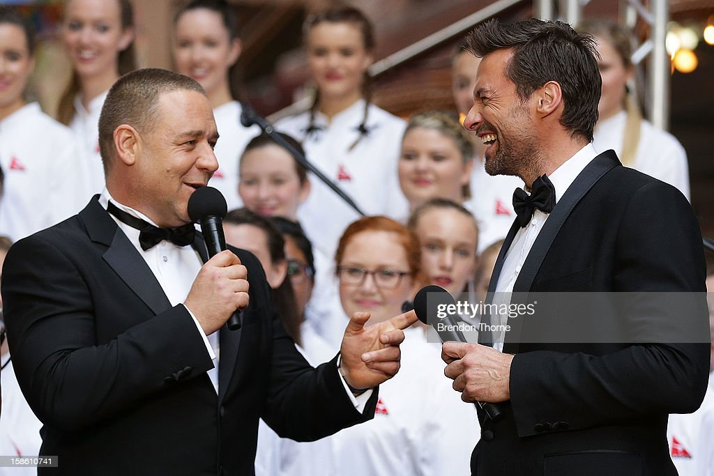 <a gi-track='captionPersonalityLinkClicked' href=/galleries/search?phrase=Hugh+Jackman&family=editorial&specificpeople=202499 ng-click='$event.stopPropagation()'>Hugh Jackman</a> and <a gi-track='captionPersonalityLinkClicked' href=/galleries/search?phrase=Russell+Crowe&family=editorial&specificpeople=202609 ng-click='$event.stopPropagation()'>Russell Crowe</a> share a joke on the red carpet during the Australian premiere of 'Les Miserables' at the State Theatre on December 21, 2012 in Sydney, Australia.