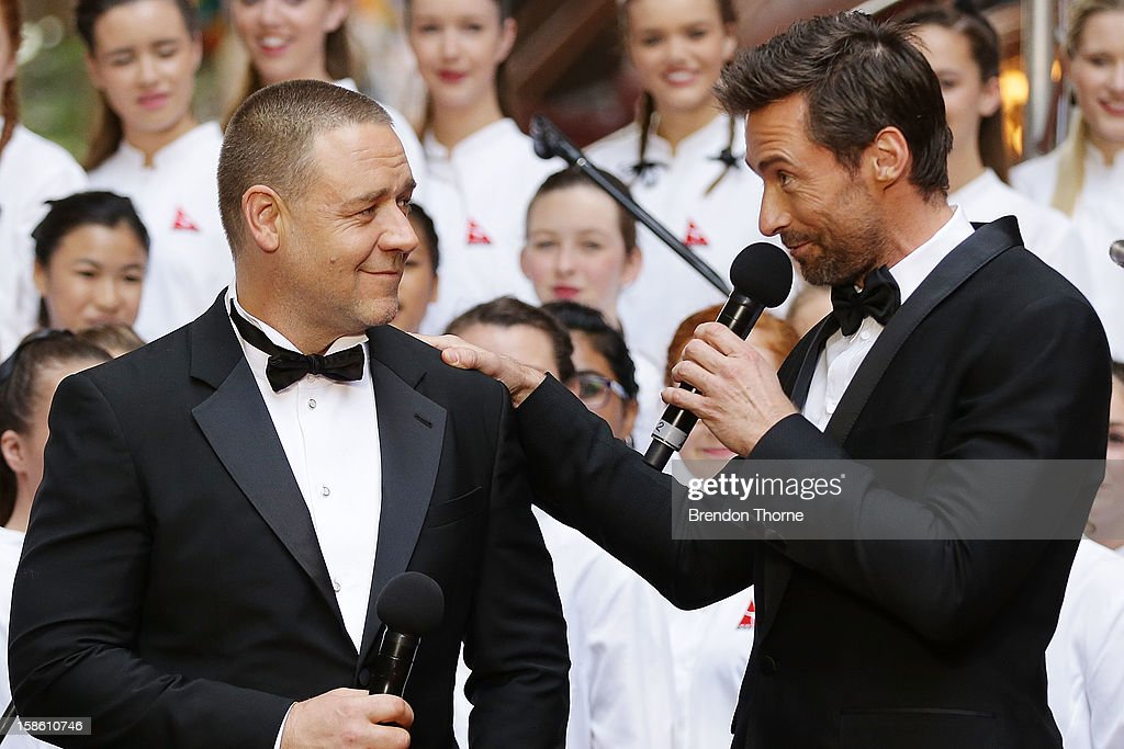 Hugh Jackman and Russell Crowe share a joke on the red carpet during the Australian premiere of 'Les Miserables' at the State Theatre on December 21, 2012 in Sydney, Australia.