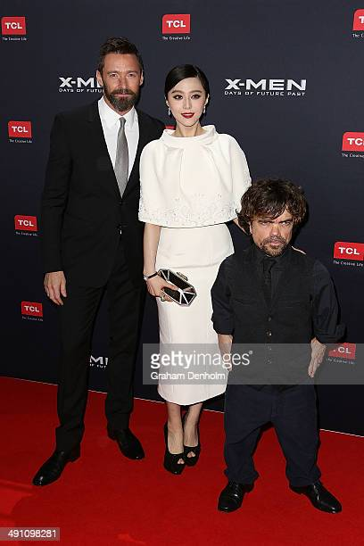 Hugh Jackman Fan Bingbing and Peter Dinklage pose as they arrive at the Australian premiere of 'XMen Days of Future Past' on May 16 2014 in Melbourne...