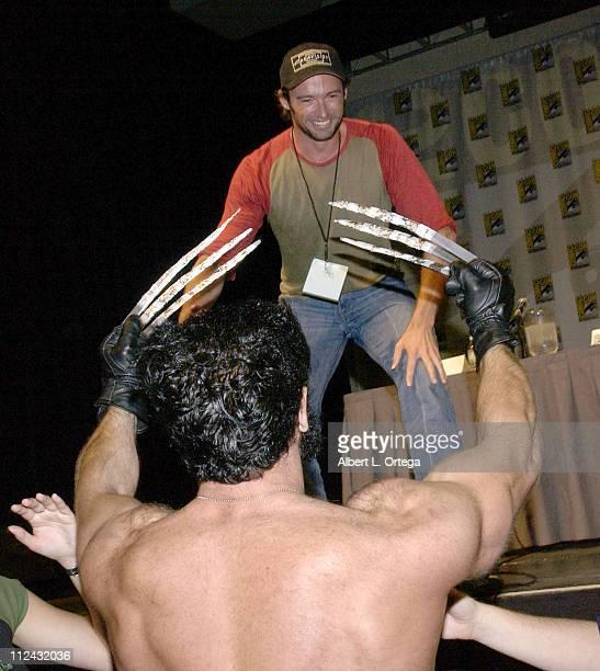 Hugh Jackman greets a Wolverine lookalike during 2003 San Diego Comic Con International Day Three at The San Diego Convention Center in San Diego...