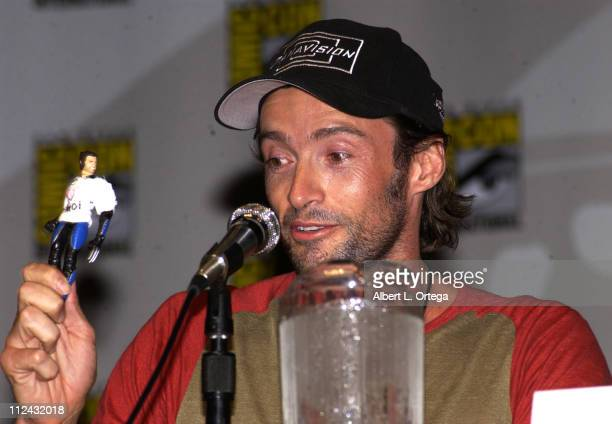 Hugh Jackman holding up his Wolverine action figure customised by a fan from 'XMen'