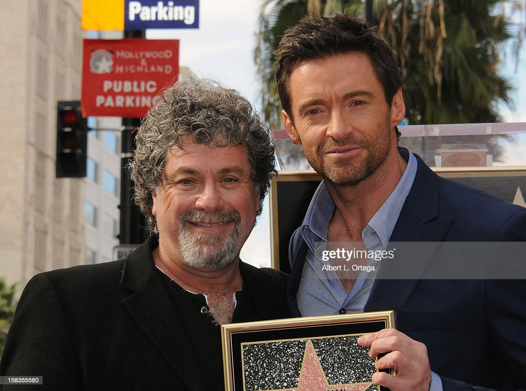 <a gi-track='captionPersonalityLinkClicked' href=/galleries/search?phrase=Hugh+Jackman&family=editorial&specificpeople=202499 ng-click='$event.stopPropagation()'>Hugh Jackman</a> Honored On The Hollywood Walk Of Fame on December 13, 2012 in Hollywood, California.