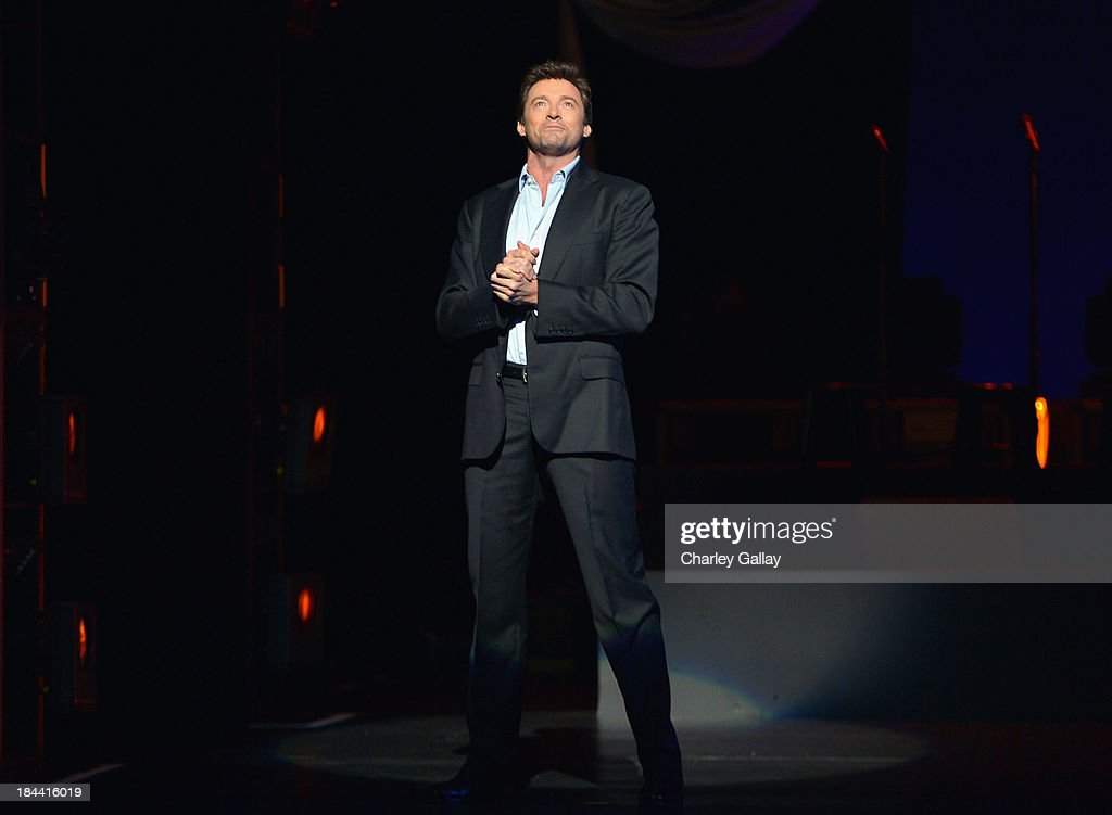 <a gi-track='captionPersonalityLinkClicked' href=/galleries/search?phrase=Hugh+Jackman&family=editorial&specificpeople=202499 ng-click='$event.stopPropagation()'>Hugh Jackman</a> performs onstage during '<a gi-track='captionPersonalityLinkClicked' href=/galleries/search?phrase=Hugh+Jackman&family=editorial&specificpeople=202499 ng-click='$event.stopPropagation()'>Hugh Jackman</a>... One Night Only' Benefiting MPTF at Dolby Theatre on October 12, 2013 in Hollywood, California.
