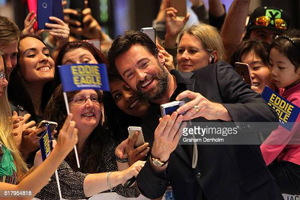 Hugh Jackman poses for selfies with fans as he arrives on the red carpet ahead of the Eddie The Eagle screening at Village Cinemas Crown on March 29...