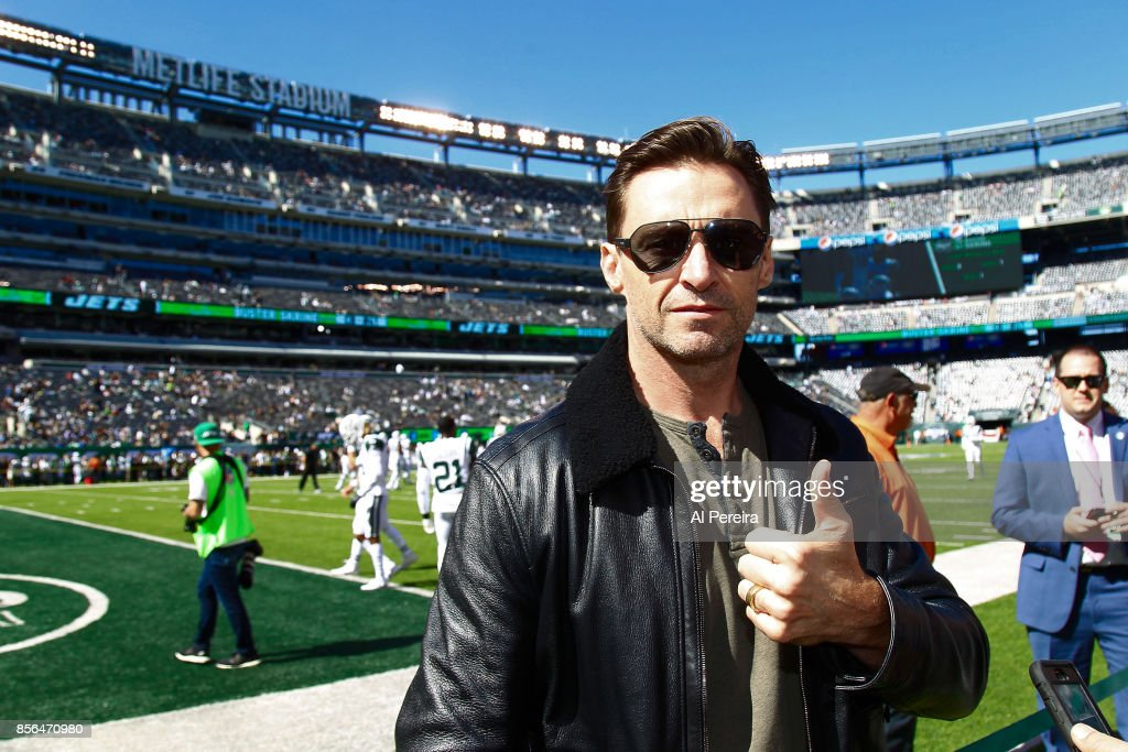 Hugh Jackman poses on the sideline when he attends the Jacksonville Jaguars vs New York Jets game at MetLife Stadium on October 1, 2017 in East Rutherford, New Jersey.