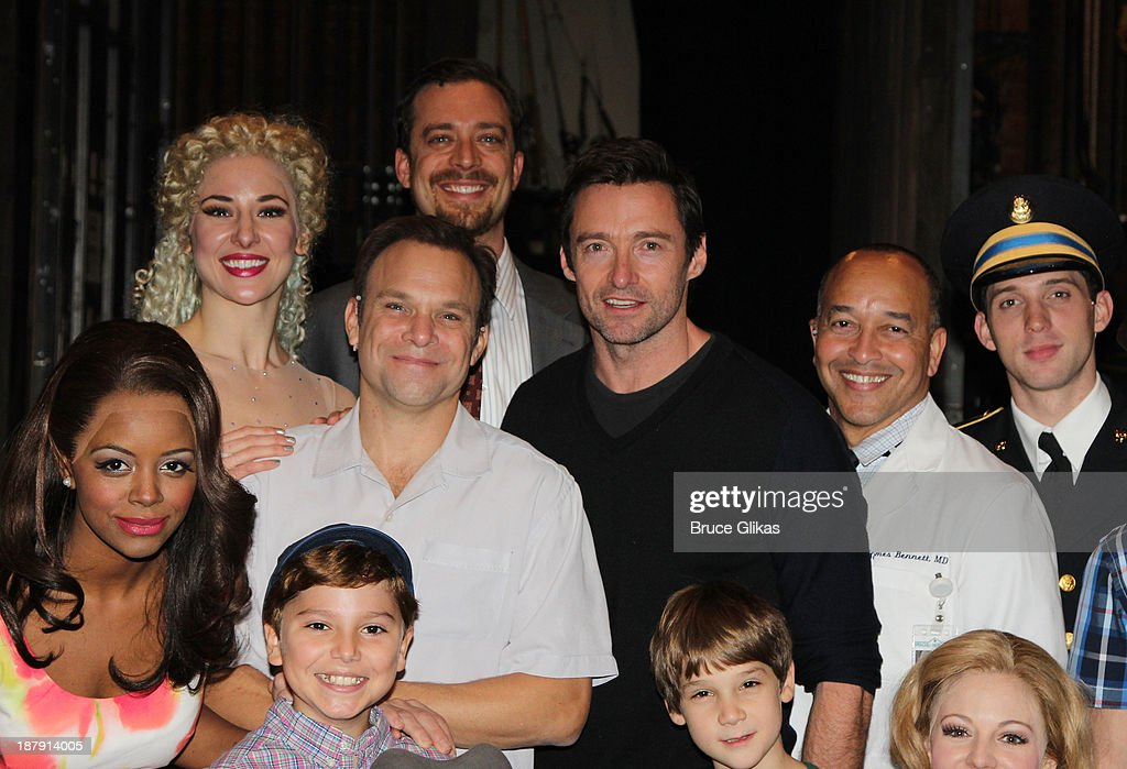 Hugh Jackman poses with the cast backstage at 'Big Fish' on Broadway at The Neil Simon Theater on November 13, 2013 in New York City.