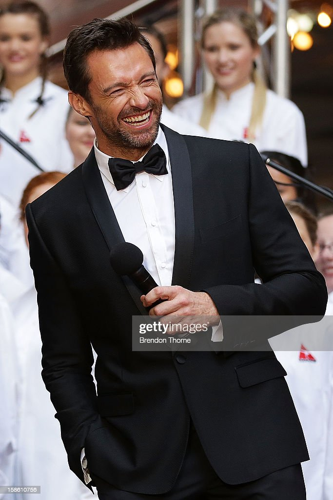 Hugh Jackman shares a joke on the red carpet with Russell Crowe during the Australian premiere of 'Les Miserables' at the State Theatre on December 21, 2012 in Sydney, Australia.
