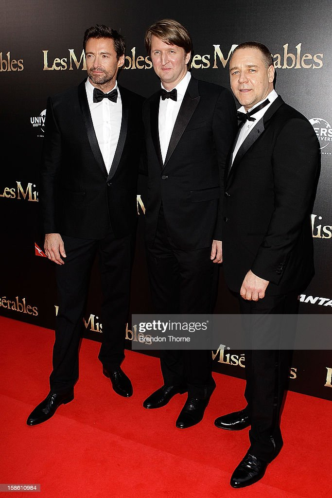 Hugh Jackman, Tom Hooper and Russell Crowe walk the red carpet during the Australian premiere of 'Les Miserables' at the State Theatre on December 21, 2012 in Sydney, Australia.