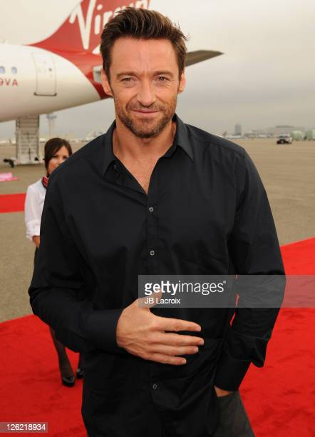 Hugh Jackman unveils the new Virgin America and DreamWorks 'Reel Steel' Plane at LAX Airport on September 23 2011 in Los Angeles California