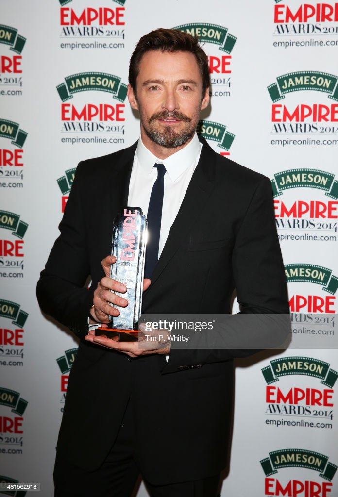 Hugh Jackman, winner of the Empire Icon Award, poses during the Jameson Empire Awards 2014 at the Grosvenor House Hotel on March 30, 2014 in London, England. Regarded as a relaxed end to the awards show season, the Jameson Empire Awards celebrate the film industry's success stories of the year with winners being voted for entirely by members of the public. Visit empireonline.com/awards2014 for more information.