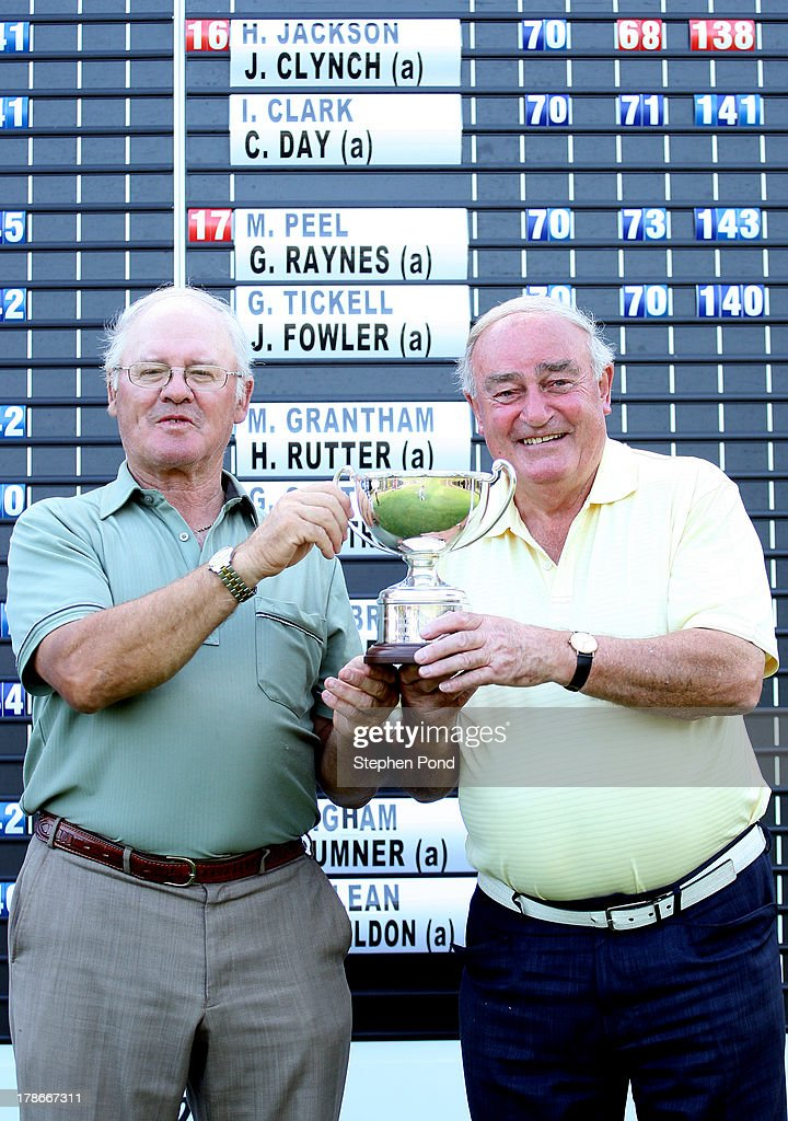 Hugh Jackson (left) and James Clynch pose with the Superb 70's Trophy after the PGA Super 60's Tournament at Thorpeness Hotel and Golf Club on August 30, 2013 in Thorpeness, England.
