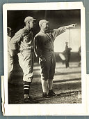 Hugh Jennings manager of the Detroit Tigers and John Henry famous Backstop for Walter Johnson of the Washington Senators in Cornell Uniforms working...