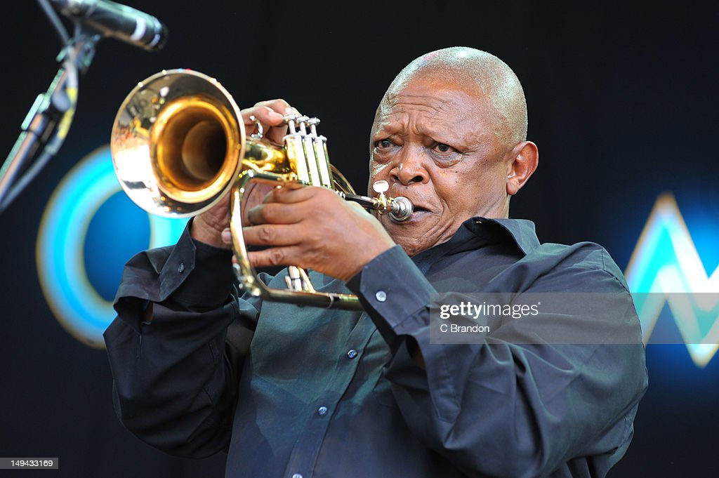 <a gi-track='captionPersonalityLinkClicked' href=/galleries/search?phrase=Hugh+Masekela&family=editorial&specificpeople=698349 ng-click='$event.stopPropagation()'>Hugh Masekela</a> performs on stage during the 30th annual world music festival Womad at Charlton Park on July 27, 2012 in Wiltshire, United Kingdom.