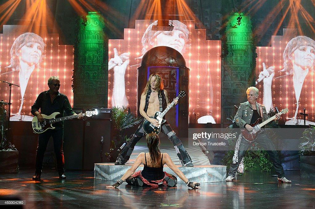 Hugh McDonald, Doug Aldrich, Carol-Lyn Liddle and Howard Leese of Raiding the Rock Vault performs at the Westgate Las Vegas Resort and Casino on August 6, 2014 in Las Vegas, Nevada.
