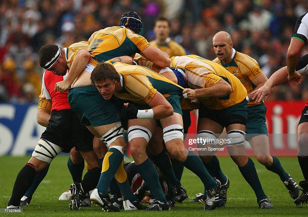 Hugh McMeniman and other Australian forwards drive the ball forward in a rolling maul during the IRB Rugby World Cup Pool B match between Australia...