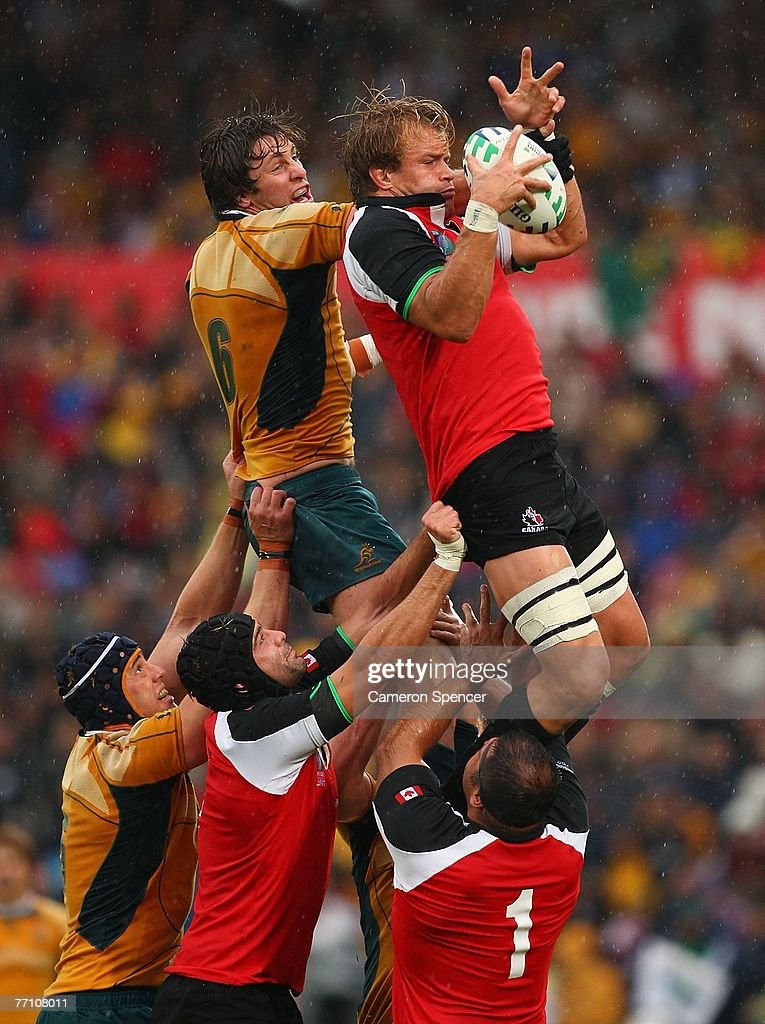 Hugh McMeniman of Australia contests a lineout ball with Mike James of Canada during the IRB Rugby World Cup Pool B match between Australia and...
