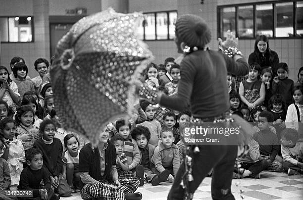 Hugh Morgan Hill a performance artist and storyteller better known as 'Brother Blue' performs for schoolchildren in the Dorchester neighborhood of...
