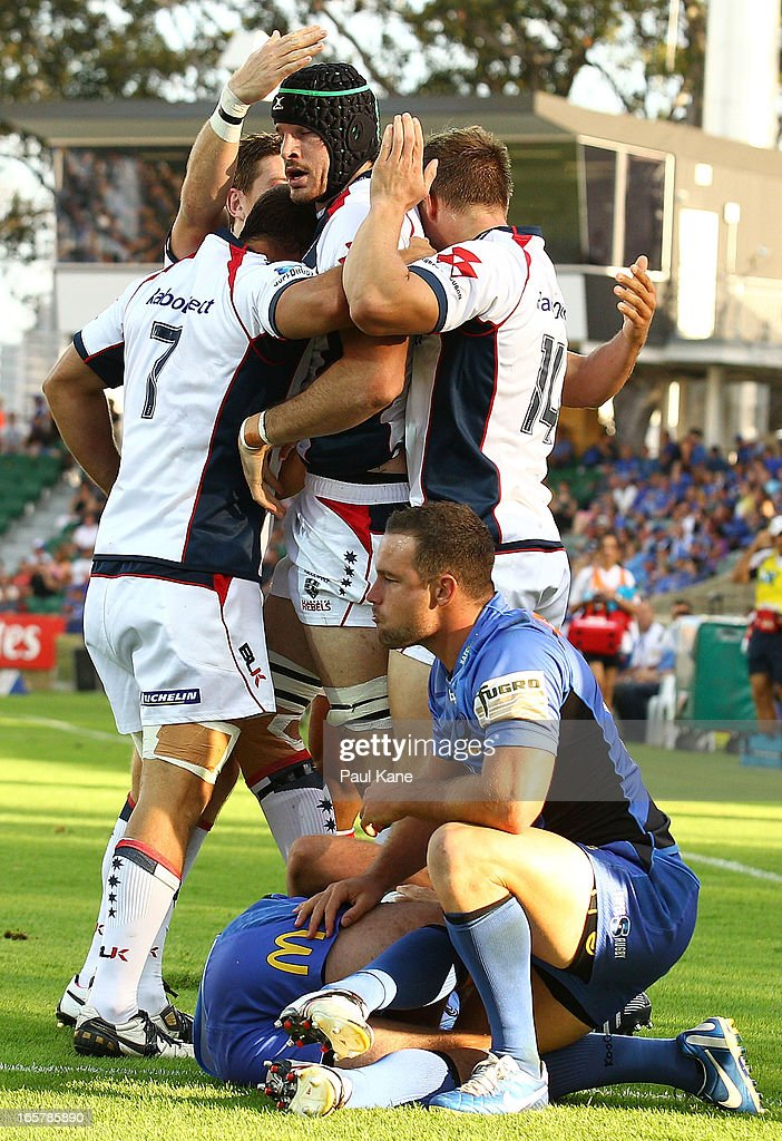 Hugh Pyle of the Rebels is congratulated after scoring the opening try during the round eight Super Rugby match between the Western Force and the Melbourne Rebels at nib Stadium on April 6, 2013 in Perth, Australia.