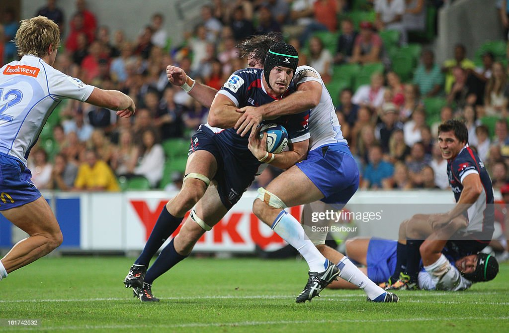 Hugh Pyle of the Rebels is tackled during the round one Super Rugby match between the Rebels and the Force at AAMI Park on February 15, 2013 in Melbourne, Australia.