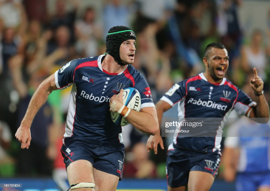 Hugh Pyle of the Rebels runs in to score a try as <a gi-track='captionPersonalityLinkClicked' href=/galleries/search?phrase=Kurtley+Beale&family=editorial&specificpeople=3020818 ng-click='$event.stopPropagation()'>Kurtley Beale</a> of the Rebels celebrates during the round one Super Rugby match between the Rebels and the Force at AAMI Park on February 15, 2013 in Melbourne, Australia.