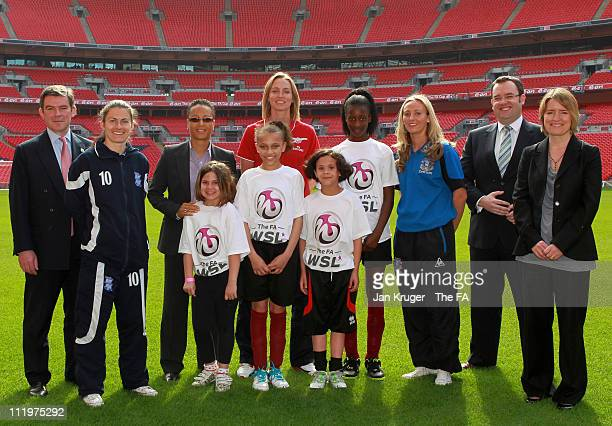 Hugh Robertson Karen Carney Hope Powell Faye White Toni Puggon Alex Horne and Kelly Simmons pose with local schoolchildren during the WSL Launch...