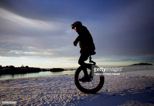 Hugh Sharp of Cape Elizabeth rides a fat tire unicycle at Kettle Cove on Feb 18 2017 Photo by Derek Davis/ Staff Photographer