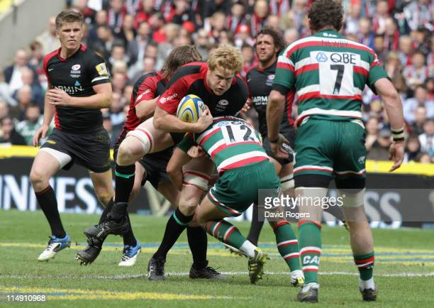 Hugh Vyvyan of Saracens drives at Anthony Allen of Leicester Tigers during the AVIVA Premiership Final between Leicester Tigers and Saracens at...