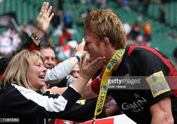 Hugh Vyvyan of Saracens is congratulated by a spectator after Saracens win during the AVIVA Premiership Final between Leicester Tigers and Saracens...