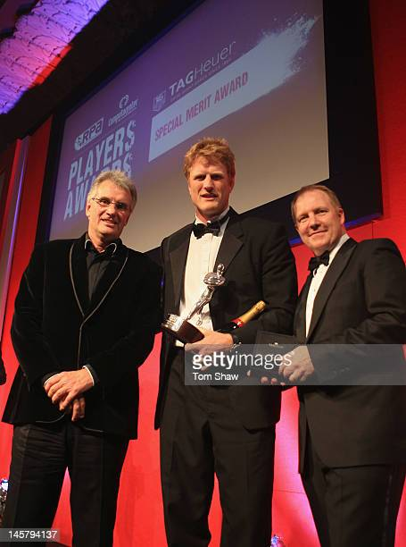 Hugh Vyvyan of Saracens poses with the TAG Heuer Special Merit Award alongside Nigel Wray Chairman of Saracens and Rob Diver of TAG Heuer during the...