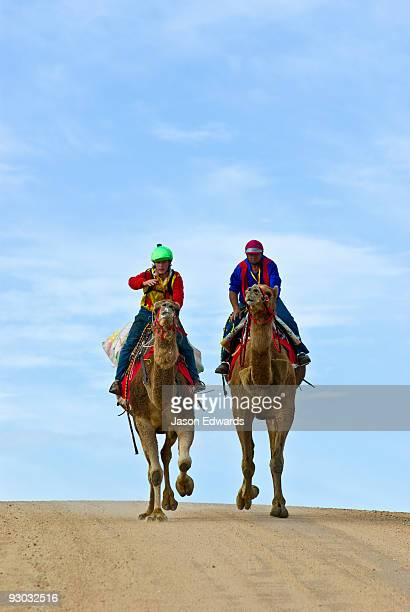 Tight competition during a camel endurance race tests man and beast.