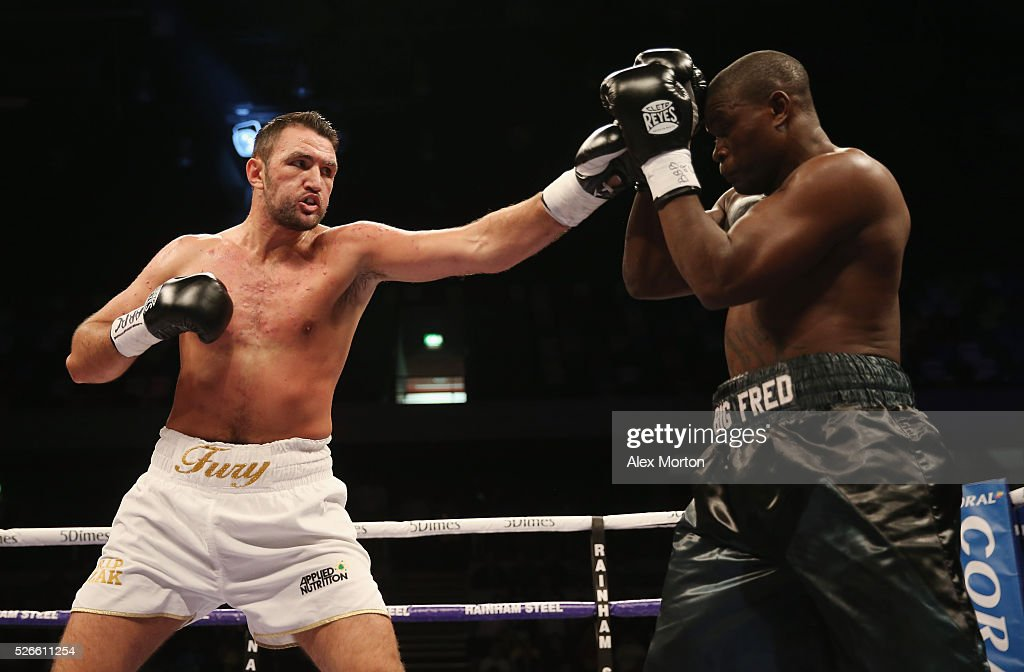 Hughie Fury (white shorts) and Fred Kassi (black shorts) during the vacant WBO Intercontinental Heavyweight Championship contest between Hughie Fury and Fred Kassi at Copper Box Arena on April 30, 2016 in London, England.