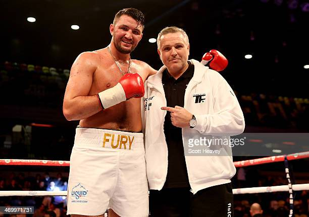 Hughie Fury celebrates his victory over Matthew Greer with Peter Fury during their International Heavyweight bout at The Copper Box on February 15...