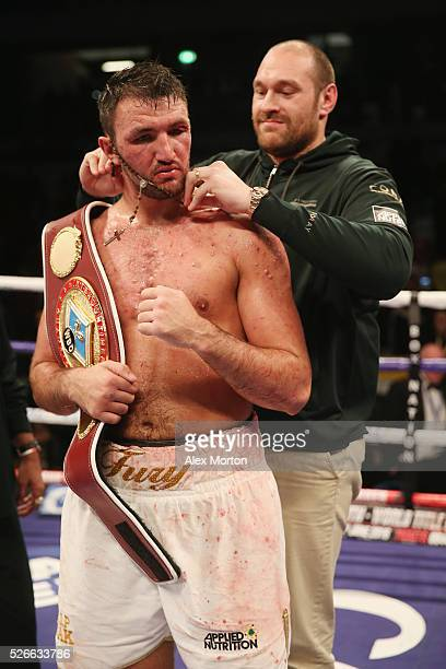 Hughie Fury celebrates victory over Fred Kassi with Tyson Fury after the vacant WBO Intercontinental Heavyweight Championship contest between Hughie...
