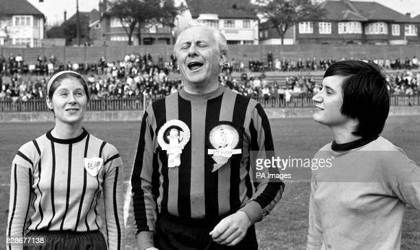 Hughie Green takes to the field with girls from Foden Ladies and Westthorn United ladies teams at the Willesden Sports Stadium London