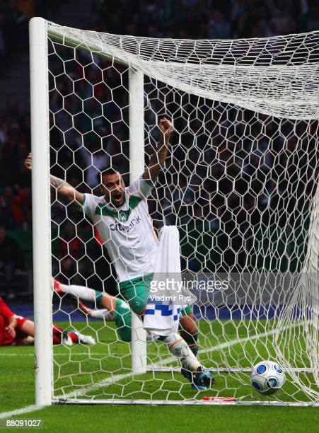 Hugo Almeida celebrates his team's first goal scored by his team mate Mesut Oezil of Bremen during the DFB Cup Final match between Bayer 04...