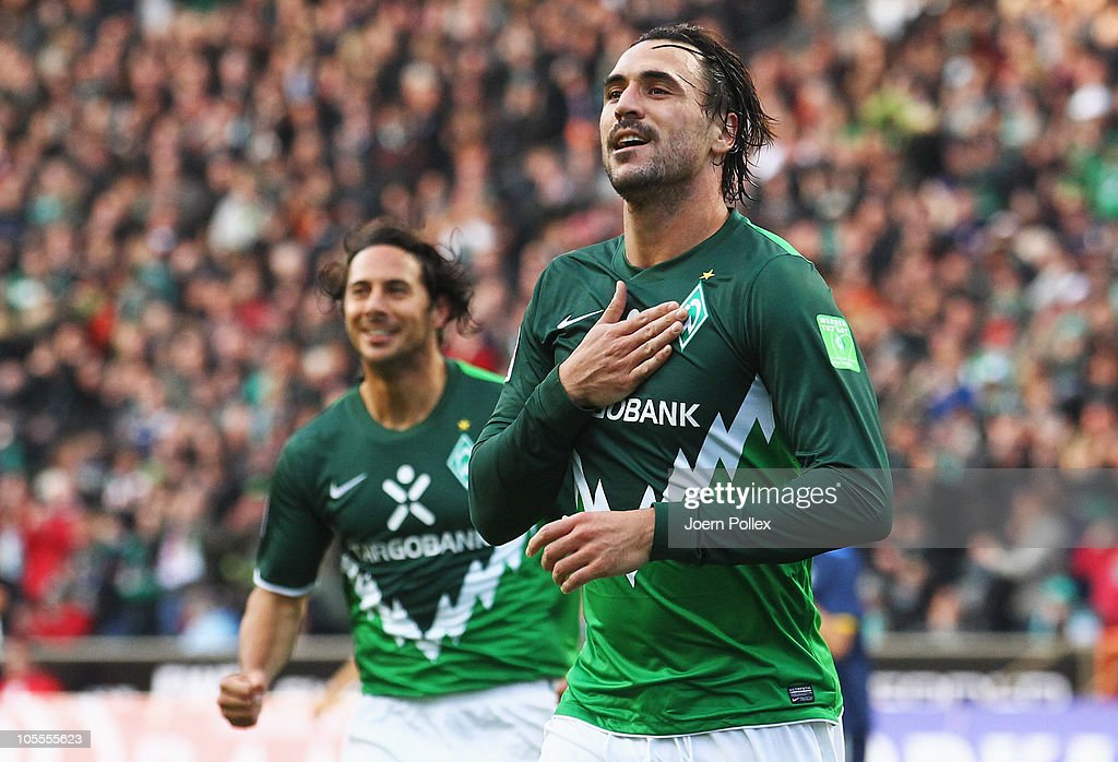 <a gi-track='captionPersonalityLinkClicked' href=/galleries/search?phrase=Hugo+Almeida&family=editorial&specificpeople=615169 ng-click='$event.stopPropagation()'>Hugo Almeida</a> (R) of Bremen celebrates after scoring his team's second goal during the Bundesliga match between SV Werder Bremen and SC Freiburg at Weser Stadium on October 16, 2010 in Bremen, Germany.